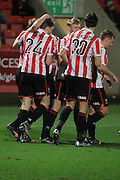 Rob Dickie scores and celebrates his hatrick during the FA Trophy match between Cheltenham Town and Chelmsford City at Whaddon Road, Cheltenham, England on 12 December 2015. Photo by Antony Thompson.