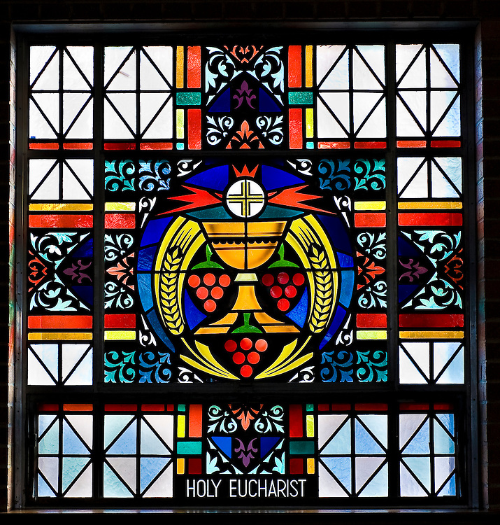 Stained glass image illustrating Sacrament of Eucharist at St. Mary Church in Peshtigo, Wis. (Sam Lucero photo)