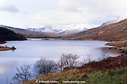 Looking across Llynnau Mymbyr lakes to Mount Snowdon early on a winter morning, Capel Curig, Snowdonia, Wales, UK