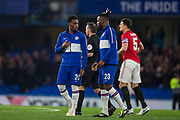Callum Hudson-Odoi (Chelsea) & Michy Batshuayi (Chelsea) talking with Paul Tierney (Referee) & Harry Maguire (Capt) (Man United) in the background ahead of the EFL Cup match between Chelsea and Manchester United at Stamford Bridge, London, England on 30 October 2019.