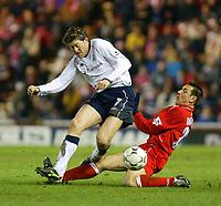Photo. Andrew Unwin.<br /> Middlesbrough v Tottenham Hotspurs, Barclaycard Premier League, Riverside Stadium, Middlesbrough 09/03/2004.<br /> Tottenham's Darren Anderton (l) is brought down by Middlesbrough's Doriva (r).