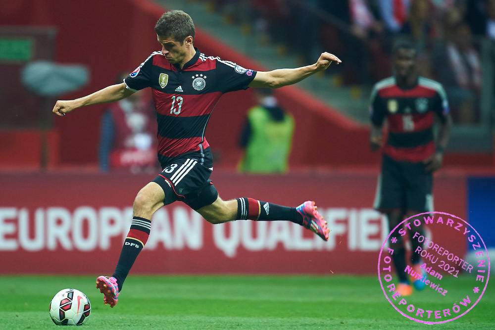 German's Thomas Muller controls the ball during the EURO 2016 qualifying match between Poland and Germany on October 11, 2014 at the National stadium in Warsaw, Poland<br /> <br /> Picture also available in RAW (NEF) or TIFF format on special request.<br /> <br /> For editorial use only. Any commercial or promotional use requires permission.<br /> <br /> Mandatory credit:<br /> Photo by &copy; Adam Nurkiewicz / Mediasport