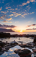 Sunset over Queens Bath on the north shore of Kauai, Hawaii, USA.