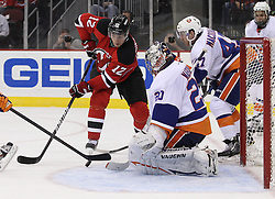 Mar 8; Newark, NJ, USA; New Jersey Devils left wing Alexei Ponikarovsky (12) takes a shot on New York Islanders goalie Evgeni Nabokov (20) during the second period at the Prudential Center.