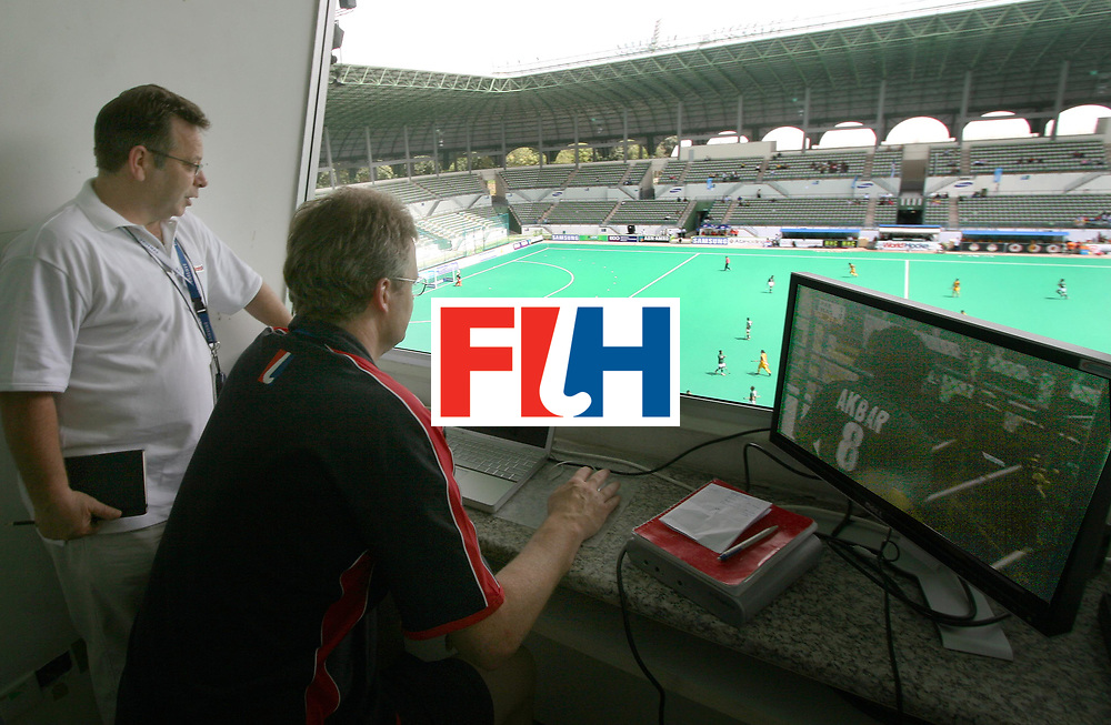 Kuala Lumpur:  Richard Wilson,  FIH Umpires Development Manager on his job of Video analysing during the Samsung Hockey Men Champions Trophy on 09 Dec 2007. With him is Rupert, Television Co ordinator of FIH.  Photo:GNN/Vino John.