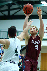 17 November 2017:  Rob Holmes gets off a shot over Zach Knobloch during an College men's division 3 CCIW basketball game between the Alma Scots and the Illinois Wesleyan Titans in Shirk Center, Bloomington IL
