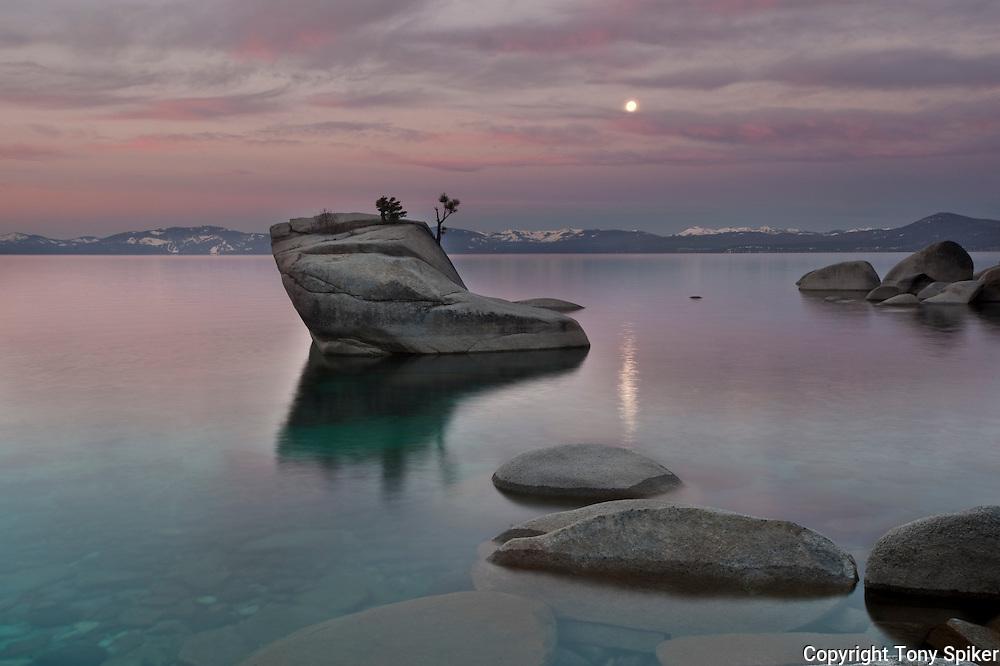 """Bonsai Rock Sunrise 7"" - The sun rises over Bonsai Rock on the Eastern shore of Lake Tahoe as the moon is setting"