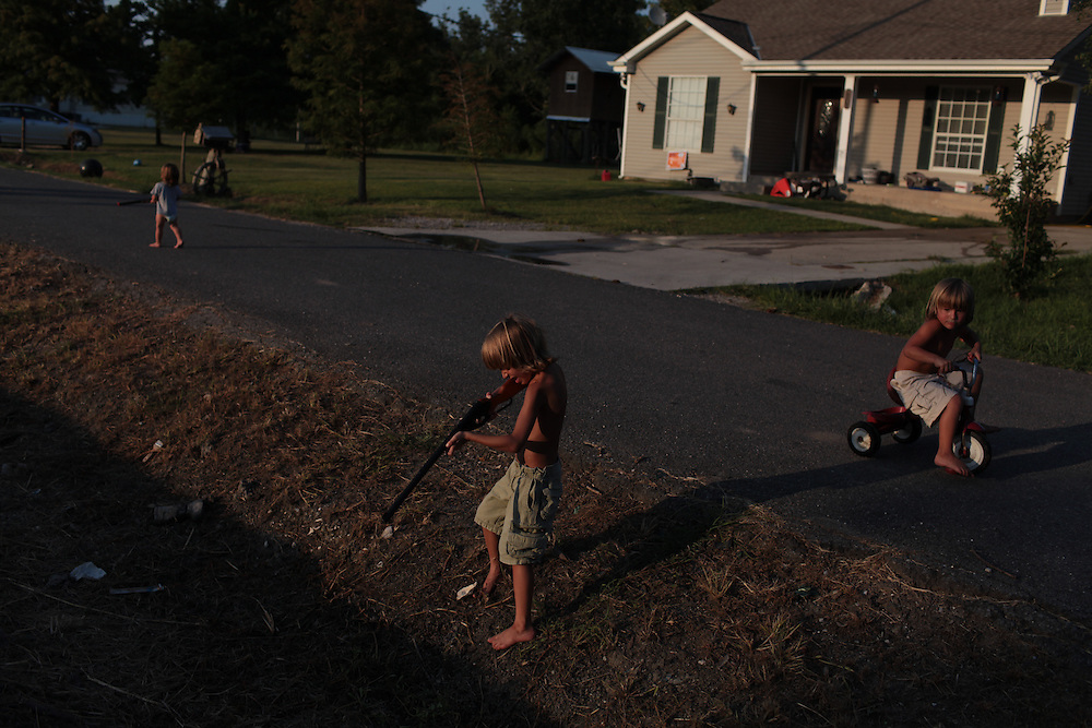 Morgan Serigne, 6, with his brothers Logan Serigne, 4, and Joseph Serigne, 1, at their home in Poydras, LA on July 30, 2010.