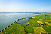 Nederland, Noord-Holland, Amsterdam, 05-08-2014; Waterland , Barnegat met Waterlandse Zeedijk (Uitdammerdijk) en IJsselmeer. Foto richting KInselmeer.<br /> Waterland with (former) seawalll, near Amsterdam. IJssel lake.<br /> luchtfoto (toeslag op standard tarieven);<br /> aerial photo (additional fee required);<br /> copyright foto/photo Siebe Swart
