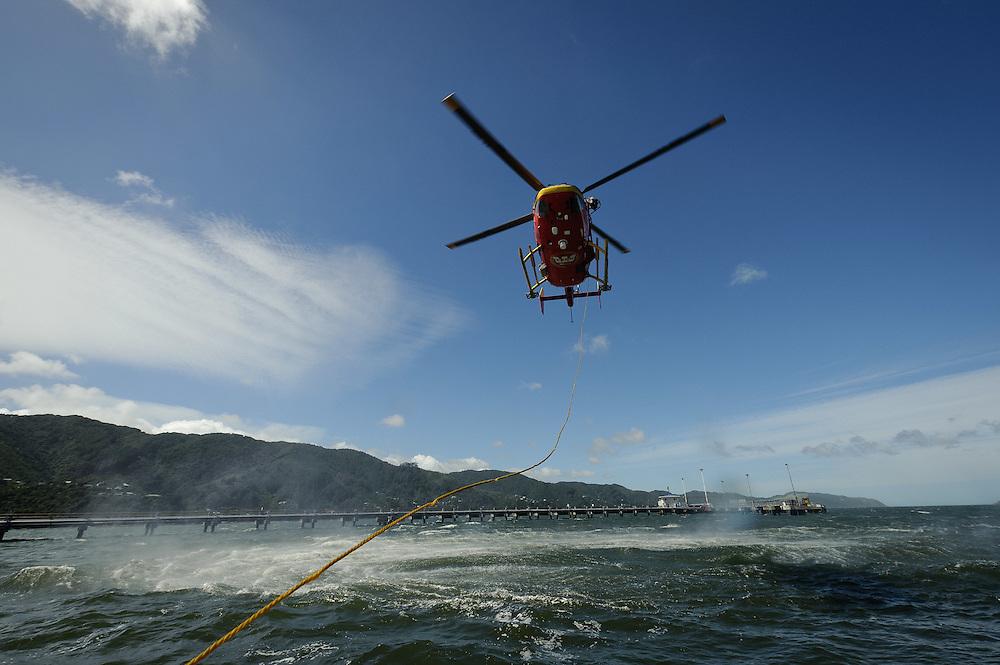 Life Flight Trust editorial coverage. January, 2012. Winch training as shot from the Wellington Coast Guard vessle...Photo by Mark Tantrum | www.marktantrum.com