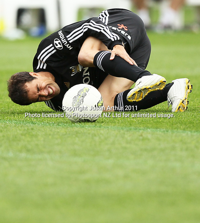 Phoenix's Daniel Cortes lies on the ground injured. A-League football - Wellington Phoenix v Melbourne Heart at Westpac Stadium, Wellington, New Zealand on Sunday 29 January 2012. Photo: Justin Arthur / Photosport.co.nz