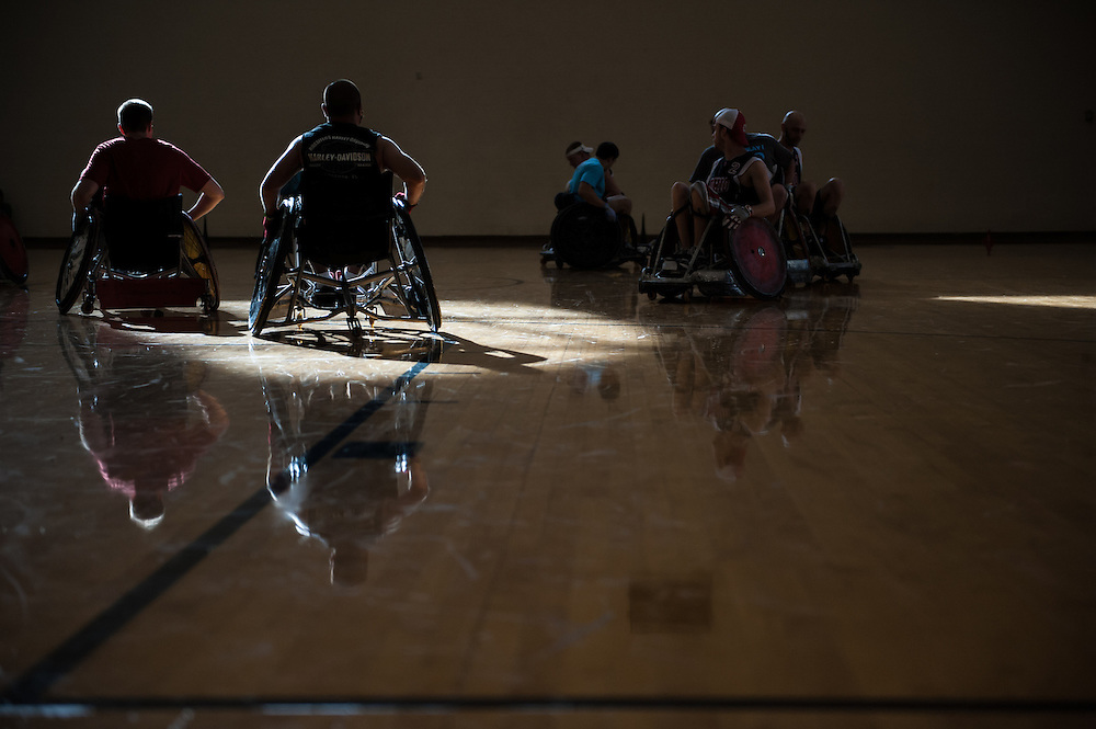 Ryan Sewell and Dale Smerglia act as defense while the rest of the team struggles for the ball during the 5th annual Quad Rugby event in the Charles J. Ping Recreation Center on September 15, 2012.