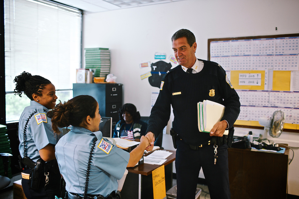 DC police commander Andy Solberg greets new officers in his district headquarters in Washington DC.