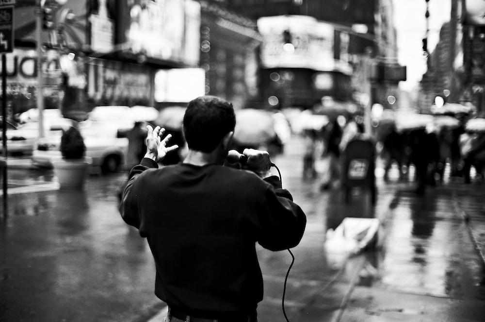 Street preacher in rain, Times Square, New York