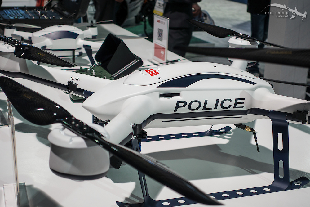 "If you put ""POLICE"" on the side of your drone, it becomes a police drone. Random drone company. CES 2016, Las Vegas."