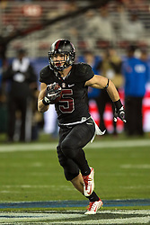SANTA CLARA, CA - DECEMBER 05:  Running back Christian McCaffrey #5 of the Stanford Cardinal rushes up field against the USC Trojans during the third quarter of the Pac-12 Championship game at Levi's Stadium on December 5, 2015 in Santa Clara, California. The Stanford Cardinal defeated the USC Trojans 41-22. (Photo by Jason O. Watson/Getty Images) *** Local Caption *** Christian McCaffrey