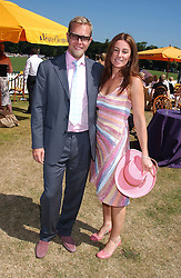 SEBASTIAN PEARSON and his wife AMANDA he is the illegitimate son of Viscount Cowdray at the Veuve Clicquot sponsored Gold Cup Final or the British Open Polo Championship held at Cowdray Park, West Sussex on 17th July 2005.<br /><br />NON EXCLUSIVE - WORLD RIGHTS