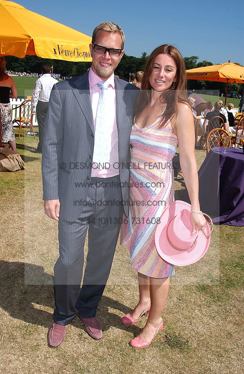 SEBASTIAN PEARSON and his wife AMANDA he is the illegitimate son of Viscount Cowdray at the Veuve Clicquot sponsored Gold Cup Final or the British Open Polo Championship held at Cowdray Park, West Sussex on 17th July 2005.<br />