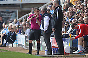 Referee A Coggins speaks to Steve Evans during the EFL Sky Bet League 1 match between Peterborough United and Rochdale at London Road, Peterborough, England on 14 April 2018. Picture by Daniel Youngs.