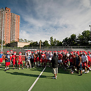 August 31, 2009 - Marble Hill, New York : The John F. Kennedy High School Knights varsity football team spent Monday conditioning, watching tapes, and running drills in preparation for their 2009 season.  Coach Alex Vega talks to the team.