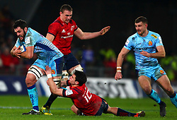 Dave Dennis of Exeter Chiefs is tackled by Joey Carbery of Munster Rugby - Mandatory by-line: Ken Sutton/JMP - 19/01/2019 - RUGBY - Thomond Park - Limerick,  - Munster Rugby v Exeter Chiefs -