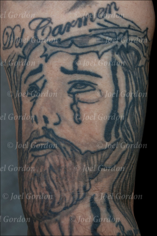 In memory for Carmen, Christ tattoo with tear on his  right upper arm.<br />
