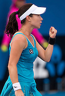 Jie Zheng (CHN)<br /> 2010 Australian Open Tennis<br /> Womens Singles<br /> First Round<br /> 18/01/10<br /> Jie Zheng of china pumps her fist in celebration of her first round win over Shuai Peng of China 0-6 6-1 6-2<br /> &quot;Court 8&quot; Melbourne Park, Melbourne, Victoria, Australia<br /> Photo By Lucas Wroe
