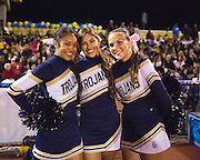 Milpitas cheerleaders pose for a photo during the Homecoming game against Saratoga at Milpitas High School in Milpitas, California, on October 10, 2014. Milpitas beat Saratoga 49-0. (Stan Olszewski/SOSKIphoto)
