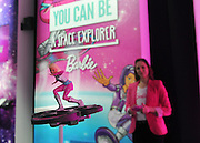 The Barbie Star Light Adventure RC Hoverboard is demonstrated at the New York Toy Fair, Friday, Feb. 12, 2016.  This RC Hoverboard, with a Barbie doll on top, really flies through the air.  (Photo by Diane Bondareff/AP Images for Mattel)
