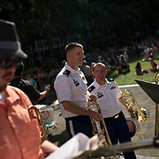 June 21, 2014 - New York, NY : <br /> The city was flooded with music on Saturday as Make Music New York brought more than 1,300 free concerts to the city's streets and parks. The annual festival's program included a performance by the Berlioz Symphony, lead by conductor Jeff W. Ball (not pictured) of the Brooklyn Wind Symphony, in Bryant Park on Saturday afternoon. Pictured here, trombonists Staff Sgt. Philip Stehly, principal trombonist with the West Point Band, center left, and Sgt. Major Matt Wizniak, also of the West Point Band, center right, chat with Brooklyn Wind Symphony trombonist Bob Bennett, right, after the concert. Sgt. Stehly performed a solo.<br /> CREDIT: Karsten Moran for The New York Times