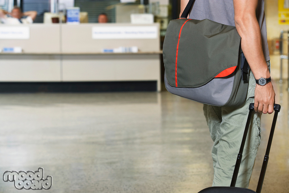 Traveller with bags at airport