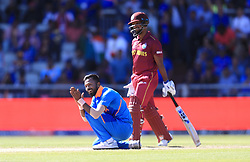 India's Hardik Pandya (left) celebrates taking the wicket of West Indies' Sunil Ambris by LBW during the ICC Cricket World Cup group stage match at Emirates Old Trafford, Manchester.