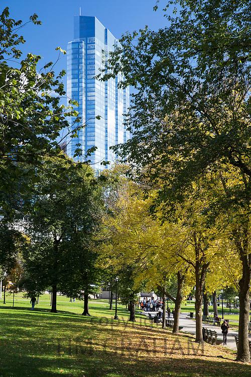 People strolling in Boston Common by the Public Garden city park in Boston, Massachusetts, USA