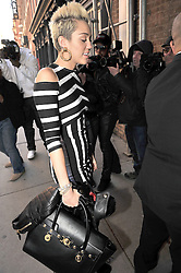(UK RIGHTS ONLY) Miley Cyrus wearing a black & white stripe dress arriving back at her hotel in New York, USA. 14/02/2013<br />