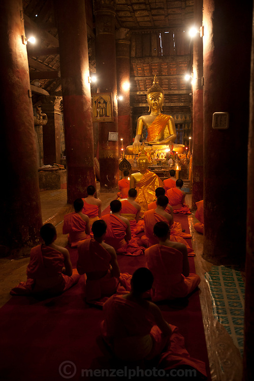 Evening prayers chanted at Wat Pak Khan, Luang Prabang, Laos.