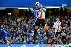 Harlee Dean of Brentford and Michy Batshuayi of Chelsea both jump to head the ball - Mandatory by-line: Jason Brown/JMP - 28/01/2017 - FOOTBALL - Stamford Bridge - London, England - Chelsea v Brentford - Emirates FA Cup fourth round