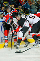 KELOWNA, CANADA, OCTOBER 26: Austin Daae #23 of the Prince George Cougars steals the puck from Kelowna Rockets #4 Madison Bowey as Prince George Cougars visit the Kelowna Rockets  on October 26, 2011 at Prospera Place in Kelowna, British Columbia, Canada (Photo by Marissa Baecker/Shoot the Breeze) *** Local Caption ***Austin Daae; Madison Bowey;