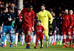 LONDON, ENGLAND - Sunday, March 17, 2019: Liverpool's Virgil van Dijk chats with his mascot before the FA Premier League match between Fulham FC and Liverpool FC at Craven Cottage. (Pic by David Rawcliffe/Propaganda)