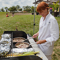 Chef Michelle Huisman cooks pork medallions flavoured with lavender at Laveanne lavender farm in Campbellcroft, Ontario.
