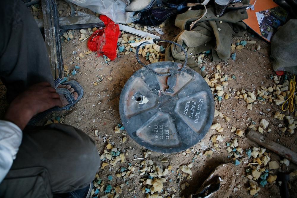 Palestinians examine Israeli explosives used to destroy dozens of homes in Jabaliya in the Gaza Strip.