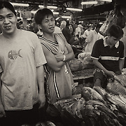 "Fisherman's Wharf in Paranaque City, Metro Manila, at 3 AM, where the fresh catch is bought in off the boats by the fishermen & sold wholesale to vendors and retail to locals based on ""bulungan"" (whispered prices between buyer and seller)."