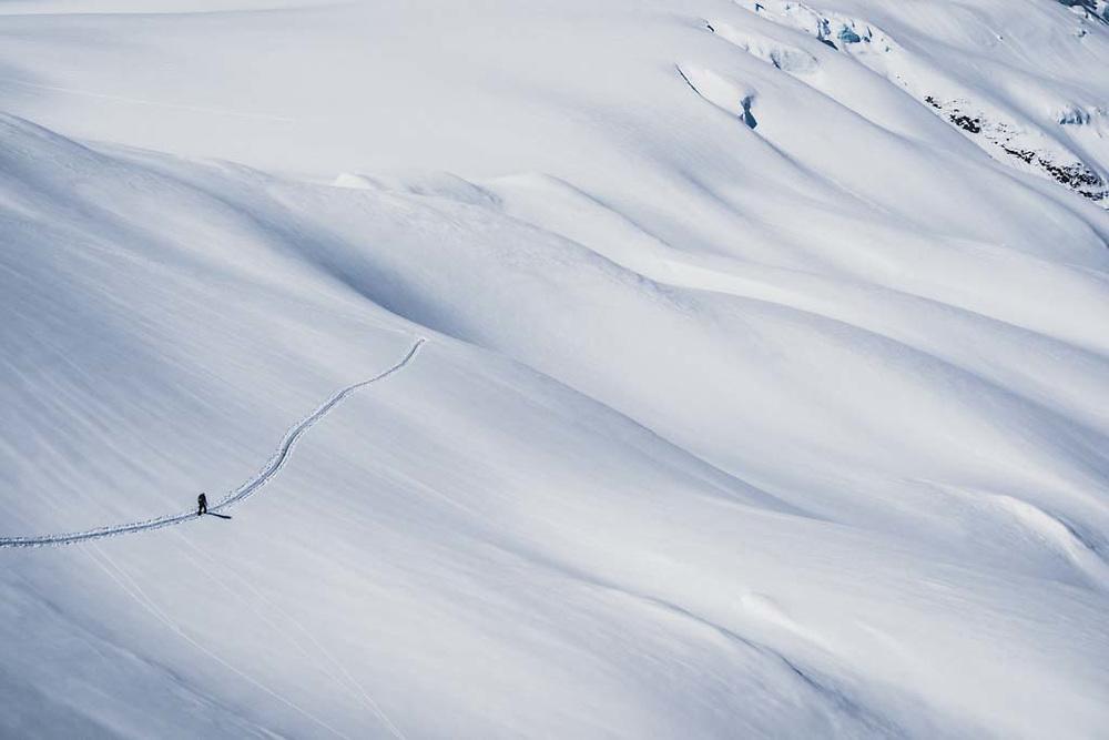 Simon Thomson out for a walk on the Loft Peak Glacier, Howson Range, British Columbia.