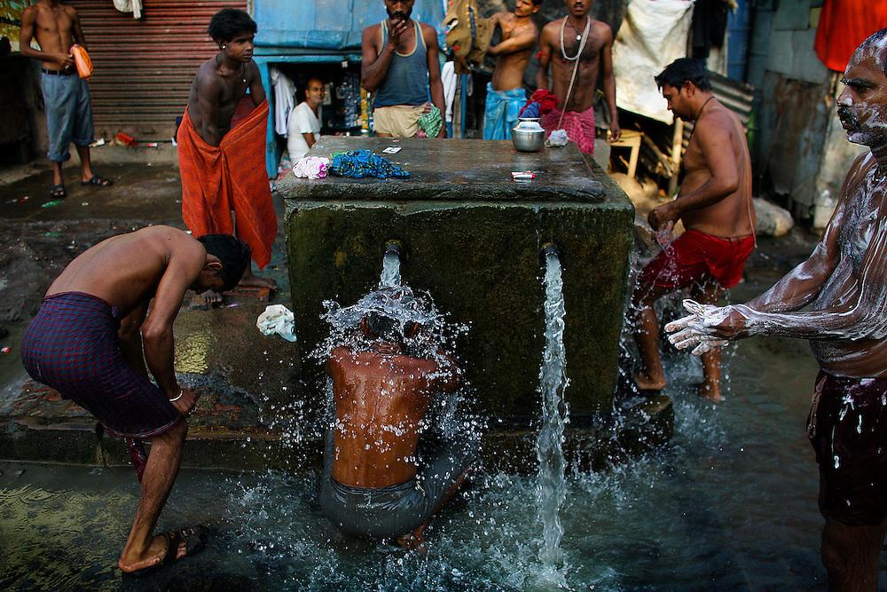 Men take baths in Kolkatta.