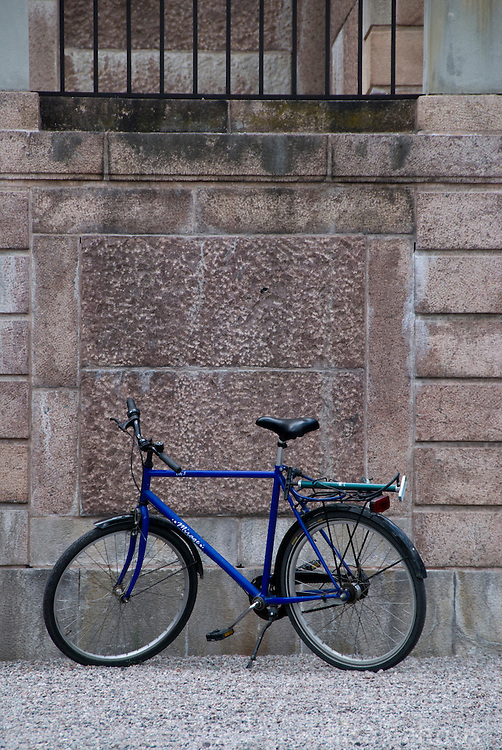A blue bicycle stands in front of the walls at Rosersbergs Slott, or Rosersberg Palace, one of the Royal Palaces of Sweden. It is situated on the shores of Lake Mälaren, on the outskirts of Stockholm.