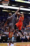 Feb 13, 2017; Phoenix, AZ, USA; New Orleans Pelicans guard E'Twaun Moore (55) drives to the basket in front of Phoenix Suns forward P.J. Tucker (17) in the second half of the NBA game at Talking Stick Resort Arena. The New Orleans Pelicans won 110-108. Mandatory Credit: Jennifer Stewart-USA TODAY Sports