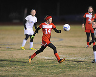 Oxford High vs. Lafayette High's Emma Wilson (8) in girls soccer action on Tuesday, December 10, 2013. The match ended in a 5-5 tie.