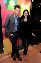 PERCY PARKER and AMY MOLYNEAUX at a party to celebrate the Firetrap Watches and Kate Moross Collaboration Launch, held at Firetrap, 21 Earlham Street, London, UK on 13th October 2010.