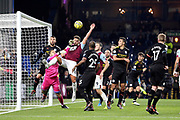 Burnley midfielder Danny Drinkwater (8) challenges Manchester City goalkeeper Ederson (31) for the corner ball during the Premier League match between Burnley and Manchester City at Turf Moor, Burnley, England on 3 December 2019.