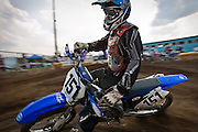 Donovan Lentz of Colville, WA rounds a hairpin corner on the motocross track at the Kootenai County Fairgrounds in Coeur d'Alene on Friday August 6, 2010.