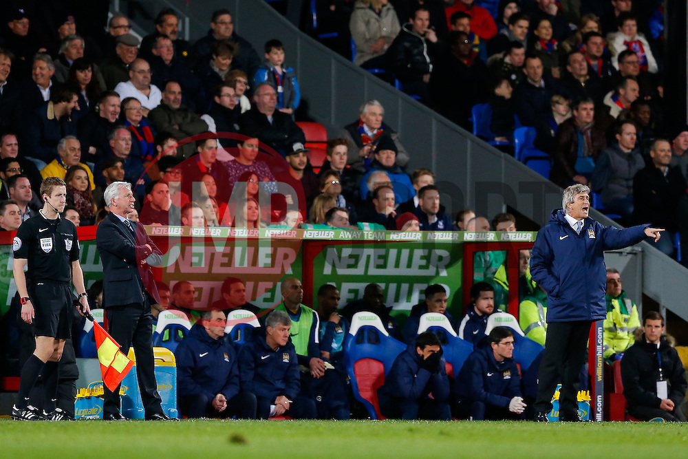 Crystal Palace Manager Alan Pardew and Manchester City Manager Manuel Pellegrini - Photo mandatory by-line: Rogan Thomson/JMP - 07966 386802 - 06/04/2015 - SPORT - FOOTBALL - London, England - Selhurst Park - Crystal Palace v Manchester City - Barclays Premier League.